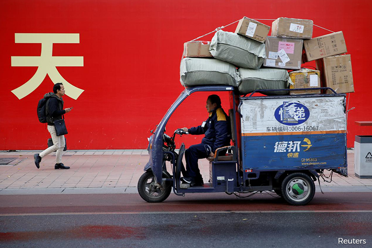 China's service sector activity expands in March after virus shock - official PMI