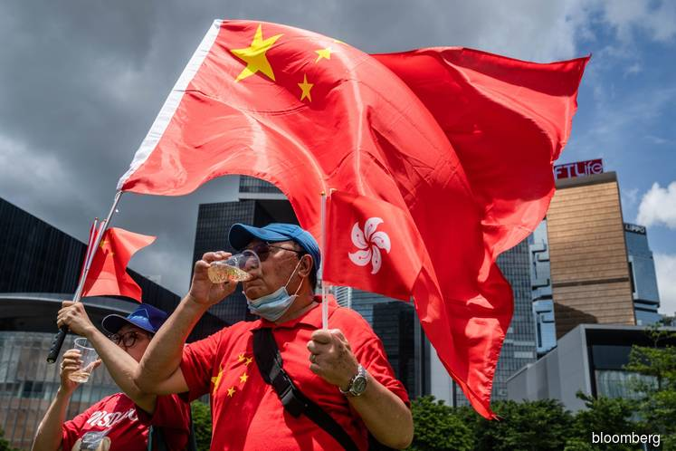 China's Xi signs order to impose Hong Kong security law