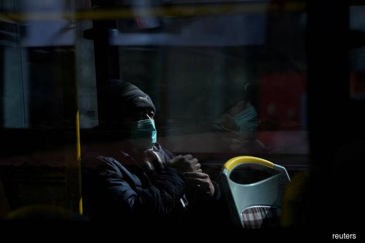 A man wears a mask on a bus in downtown Shanghai, China, on Feb 12, 2020, as the country suffers the consequences of the 2019 novel coronavirus (Covid-19) outbreak since December 2019. (Photo credit: Aly Song/REUTERS)