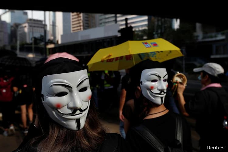 China says Hong Kong courts have no power to rule on face mask ban