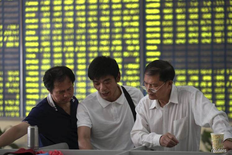 China stocks fall as US rate cut expectations ease; new listings weigh