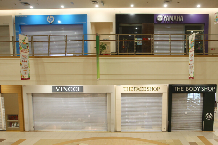 Shops closed in a mall during the Movement Control Order. (Photo by Patrick Goh/The Edge)