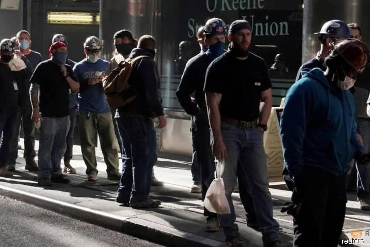 US economy suffers job losses as Covid-19 ravages restaurants, bars