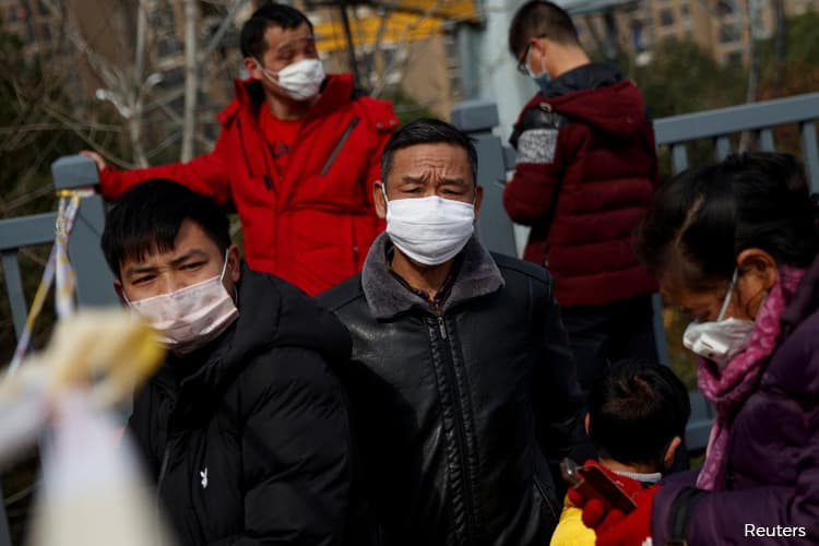 China to let key industries resume work in Wuhan, epicentre of virus outbreak