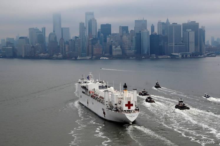 New York cheers arrival of hospital ship as coronavirus cases soar