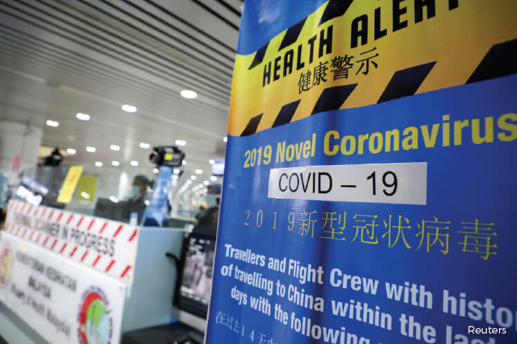 A banner about Covid-19 at the Kuala Lumpur International Airport in Sepang last Tuesday. Cuepacs suggests that the government consider including Covid-19 in the list of infectious diseases that allows for quarantine leave. (Photo by Reuters)