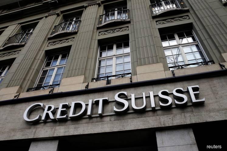 Credit Suisse cuts profit goals as revenue hopes fall short