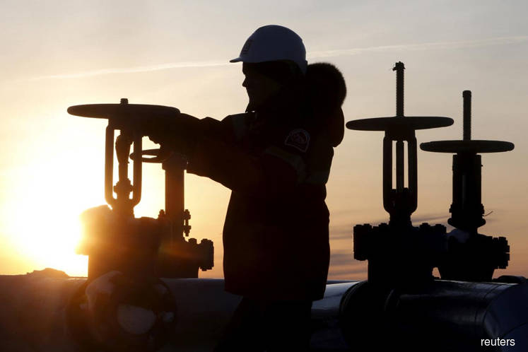 Oil gains ahead of OPEC+ meeting, boosted by fall in U.S. stockpiles