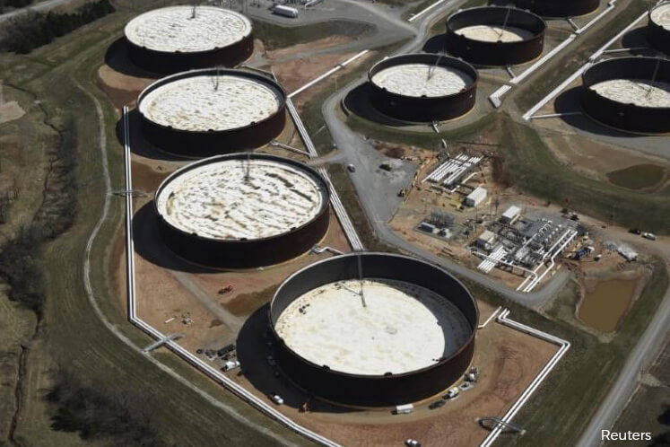 Oil prices inch down as oversupply concerns fester