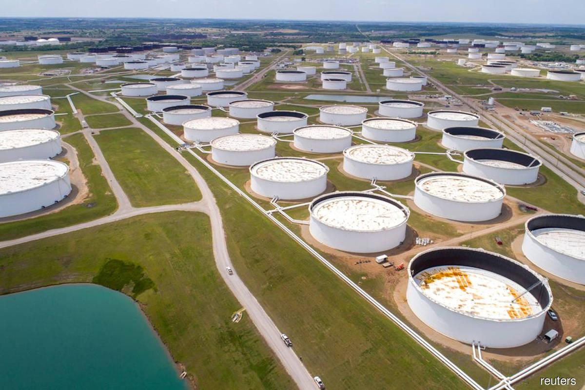 Oil settles near US$75, at multi-year highs