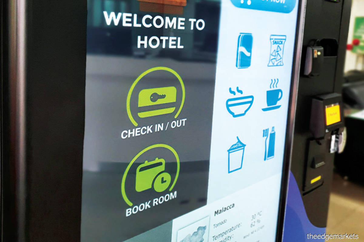 The hybrid kiosk features a 50in screen where users can check in, check out and purchase goodies
