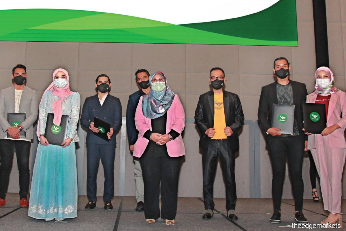 From left: Hisyam Hamid, Wawa Zainal, Aeril Zafrel, Sheikh Muszaphar, Datuk Mas Ermieyati Samsudin, To, Raf Yaakob and Mawar Rashid at the launch of Aladdin1