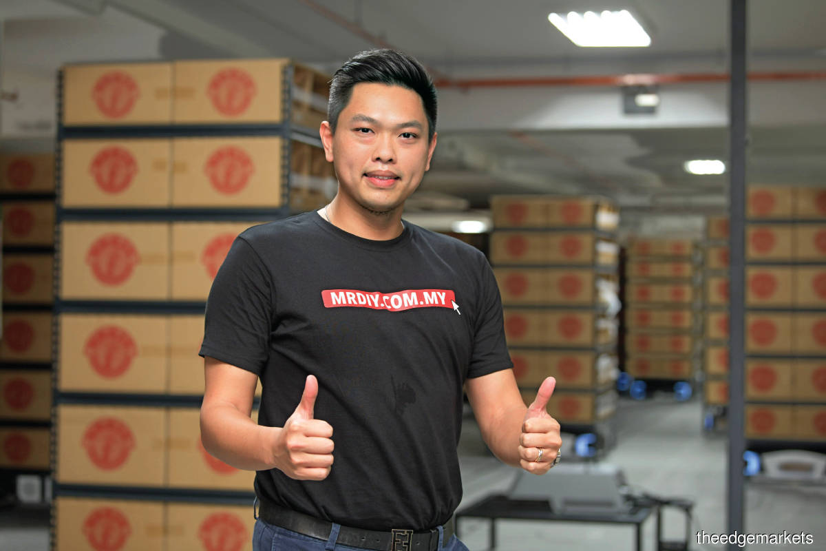 """""""In the online business world, we have to fulfil orders within 48 hours. If you don't have sufficient resources to prepare those orders, it will result in many issues. A robotic warehouse enables us to manage the fluctuations  in orders  better."""" - Chin (Photos by Sam Fong/The Edge)"""