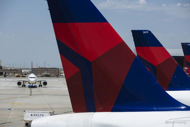 Delta, citing planes with one passenger, wants to pare schedule