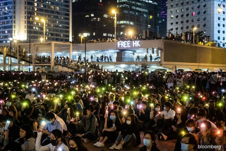 Justice Minister Hurt; Elderly Worker Dies: Hong Kong Update