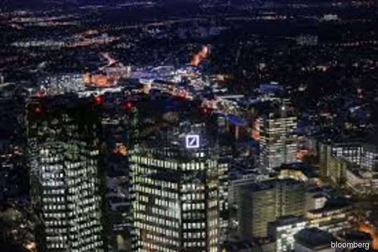 Deutsche Bank cuts revenue goal after merger talks collapse