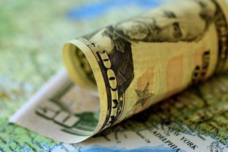 Dollar flat in thin trade with Europe on holiday