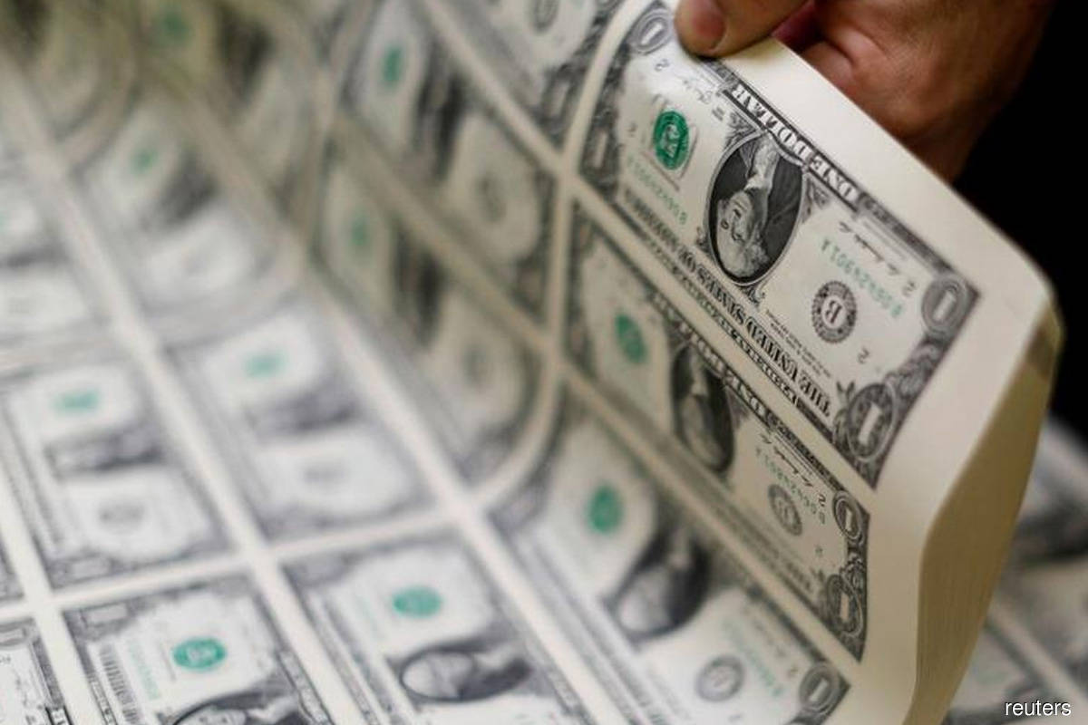 US dollar rises on hawkish comments; stocks end up