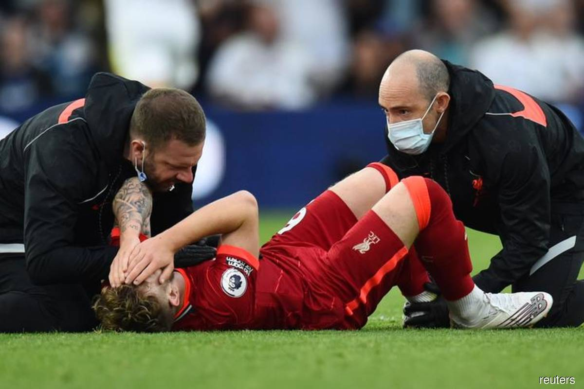 Liverpool's Elliott's needs surgery after serious ankle injury