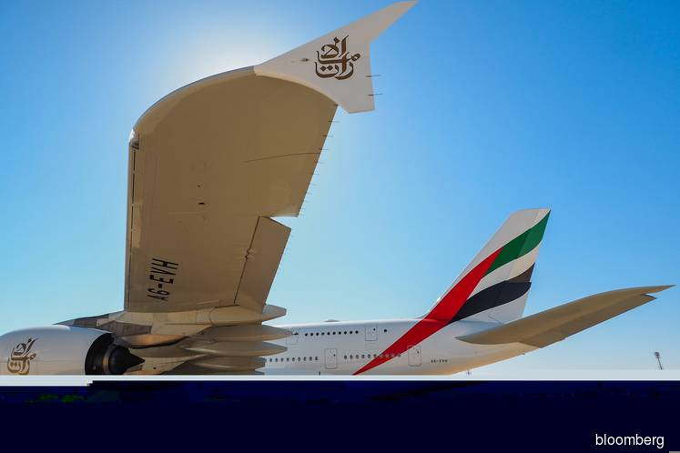 An Airbus SE A380-800 aircraft, operated by Emirates, sits in Riyadh. (Photo credit: Ryan Olson/Bloomberg)