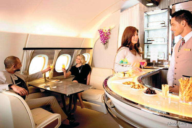 There is still a bartender on Emirates' top deck.