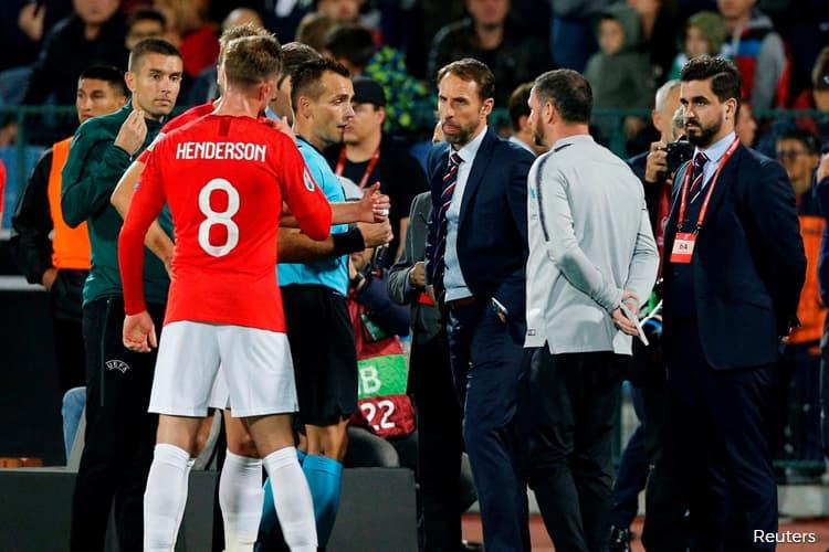 England thrash Bulgaria after game halted over racist abuse