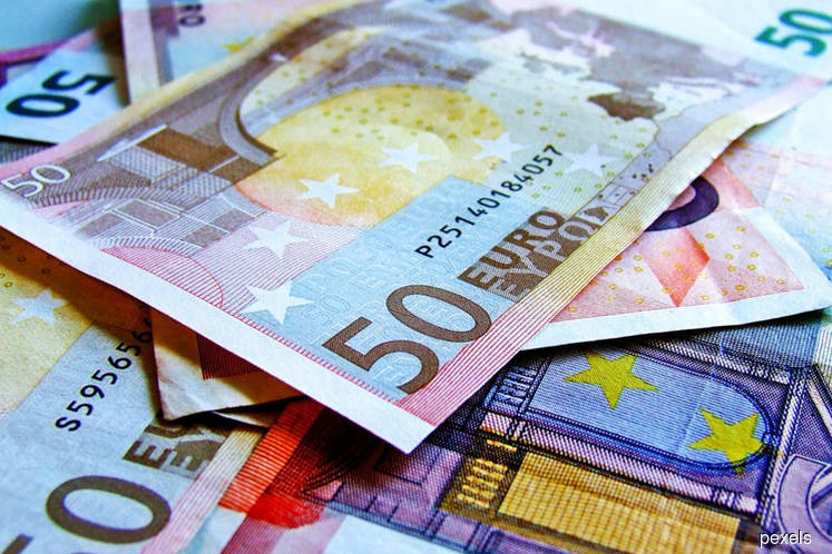 The euro wallowed close to a 21-month low against the dollar on Friday, hurt by a series of dovish signals from the European Central Bank, and the currency market braced for further volatility ahead of US jobs data later in the day.