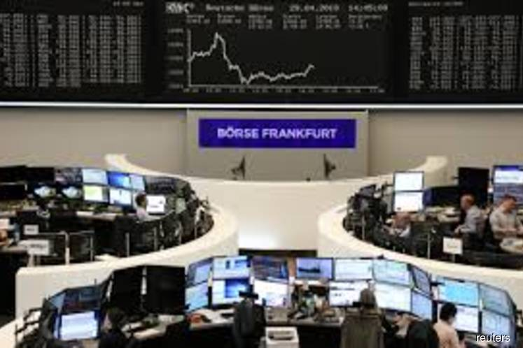 European shares reverse course to end higher on defensive plays