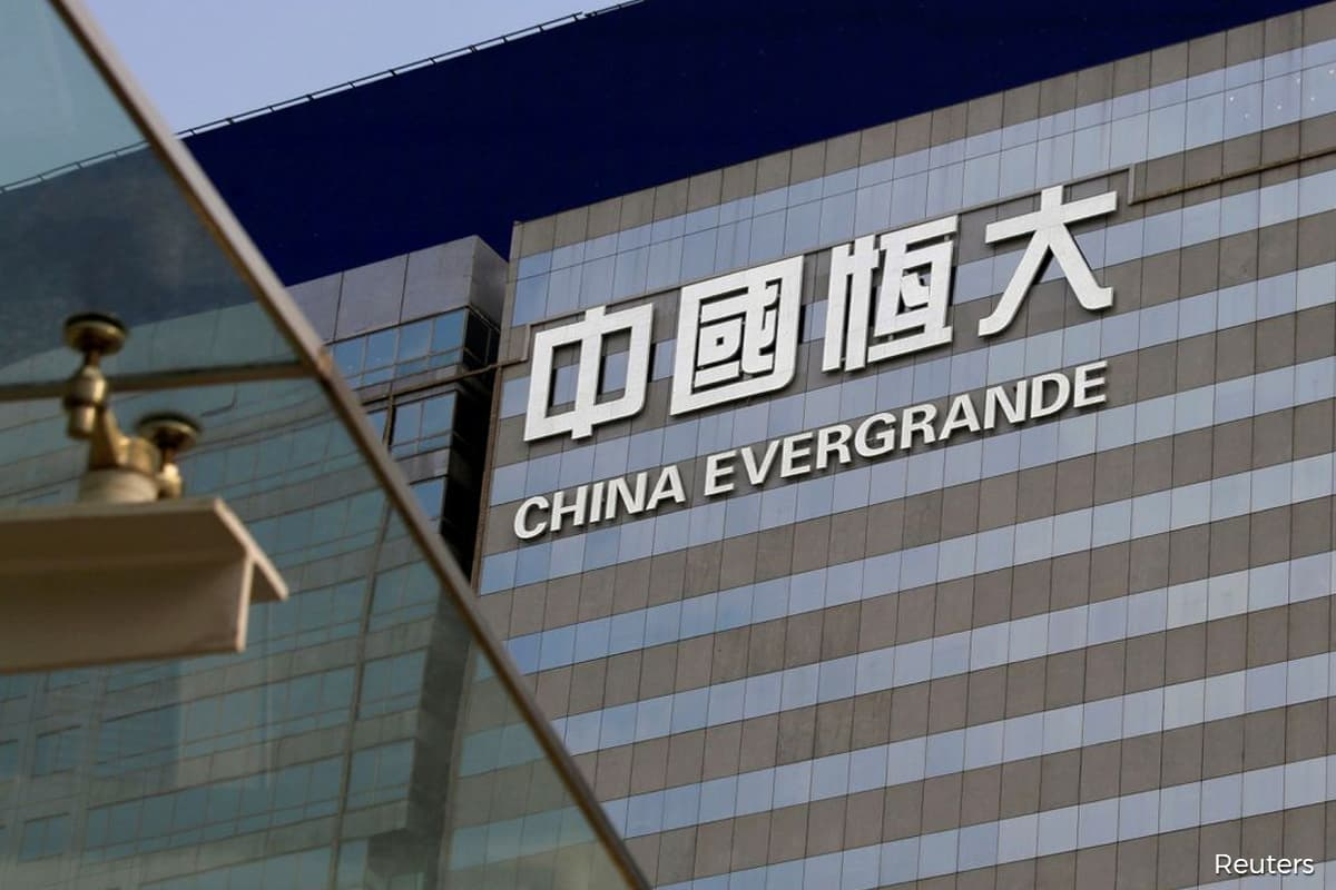 Evergrande's worsening crisis piles pressure on founder to act fast