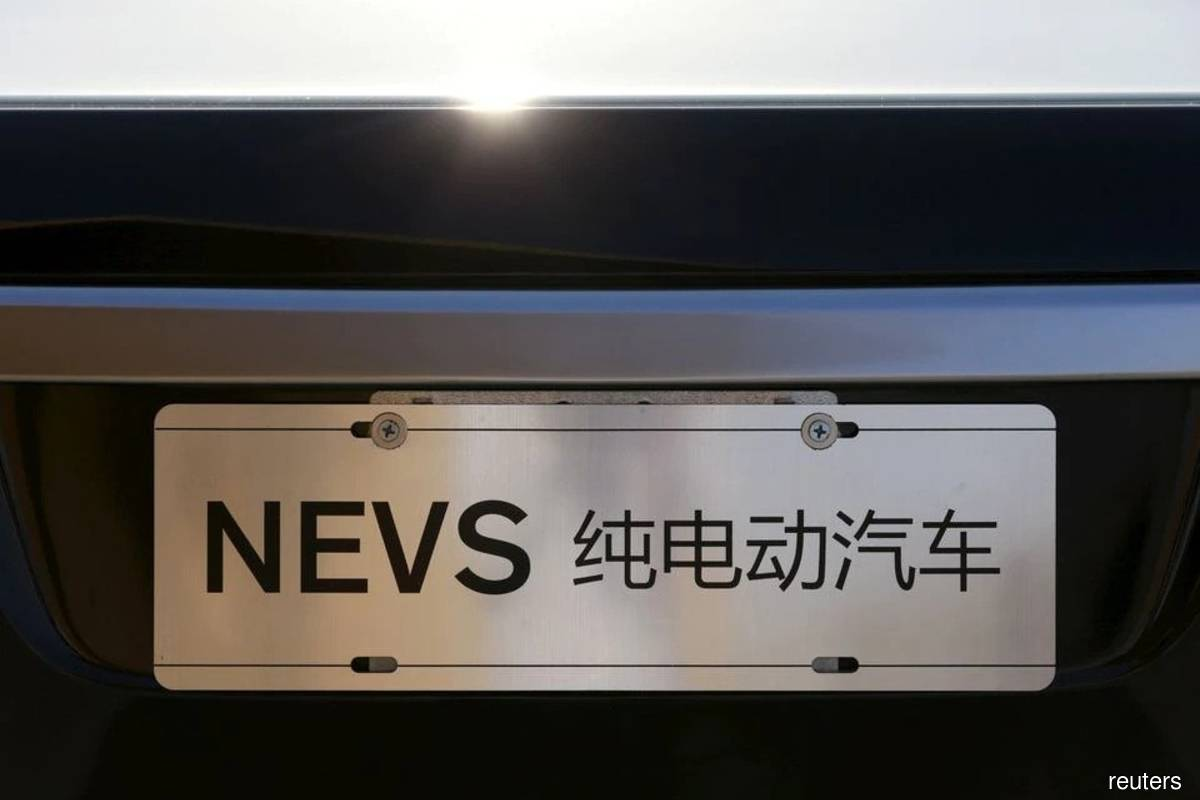 The National Electric Vehicle Sweden (NEVS) logo is pictured on one of its electric cars at its Beijing headquarters building Dec 28, 2015. (Photo by Kim Kyung-Hoon/Reuters filepix)