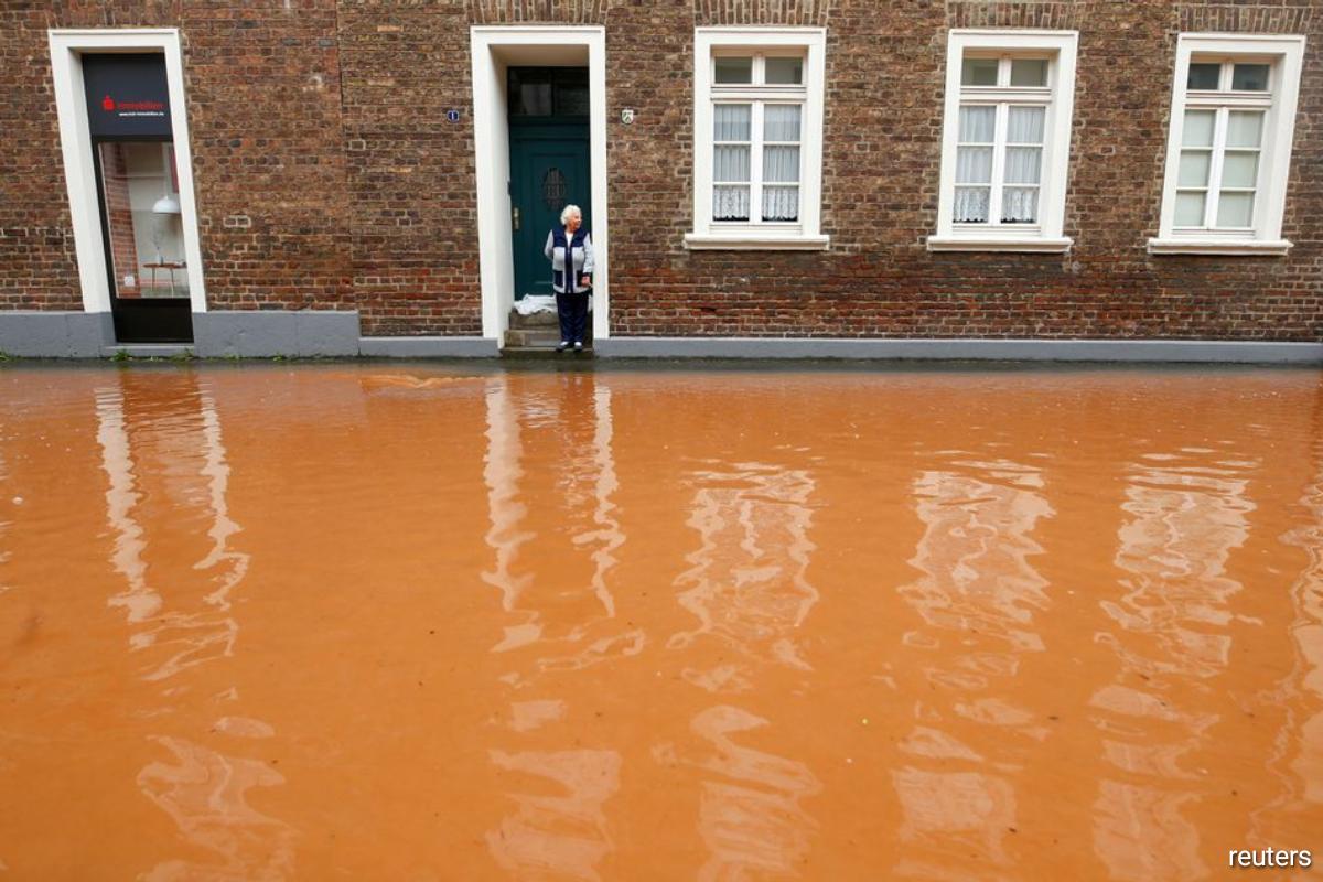A street is flooded following heavy rainfalls in Erftstadt, Germany, July 16, 2021.
