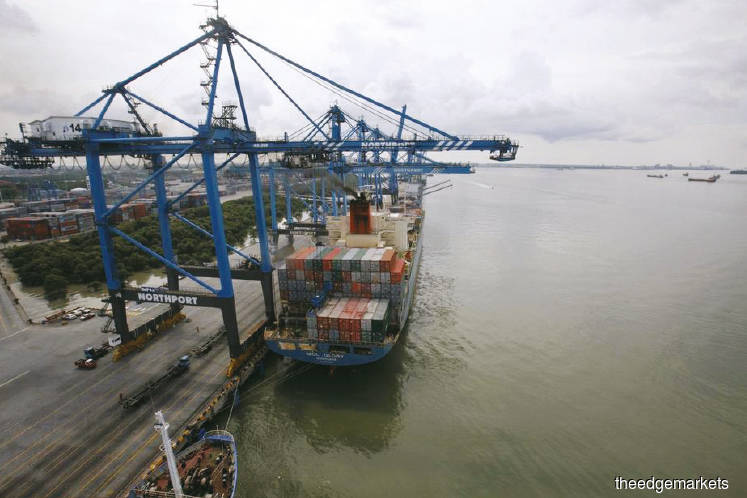 Filepic of a container ship being anchored at North Port in Port Klang. Goods that once occupied these containers are now filling up third-party warehouses in the country. (Photo by Reuters)