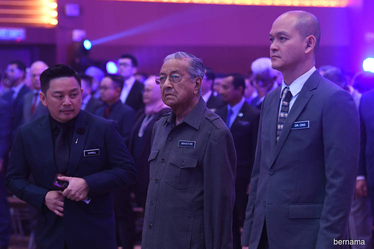 From left: Minister of International Trade and Industry Datuk Darell Leiking, Dr Mahathir and Deputy Minister of International Trade and Industry Dr Ong Kian Ming at the launch of the NAP 2020. (Photo by Bernama)
