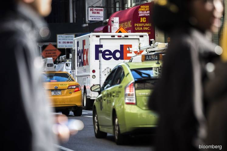 FedEx Sees `Transition Year' as Trade Woes Damp E-Commerce Gains