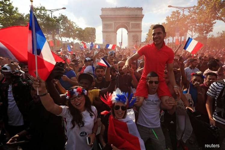 France fans go wild from Paris to Moscow after World Cup win