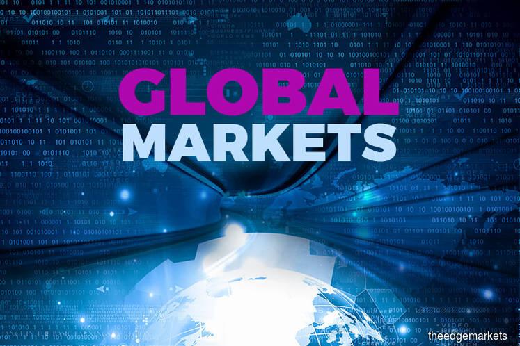 Stocks near record highs on trade hopes, dollar gains