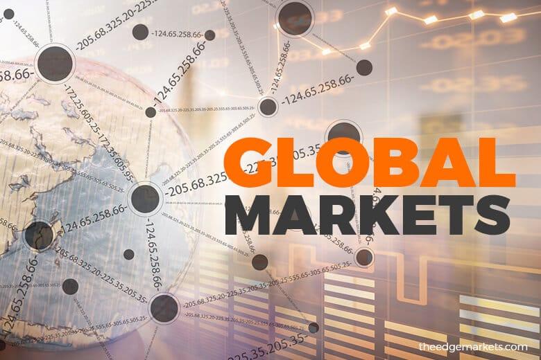 Stocks mixed as trade war simmers; Aussie jumps