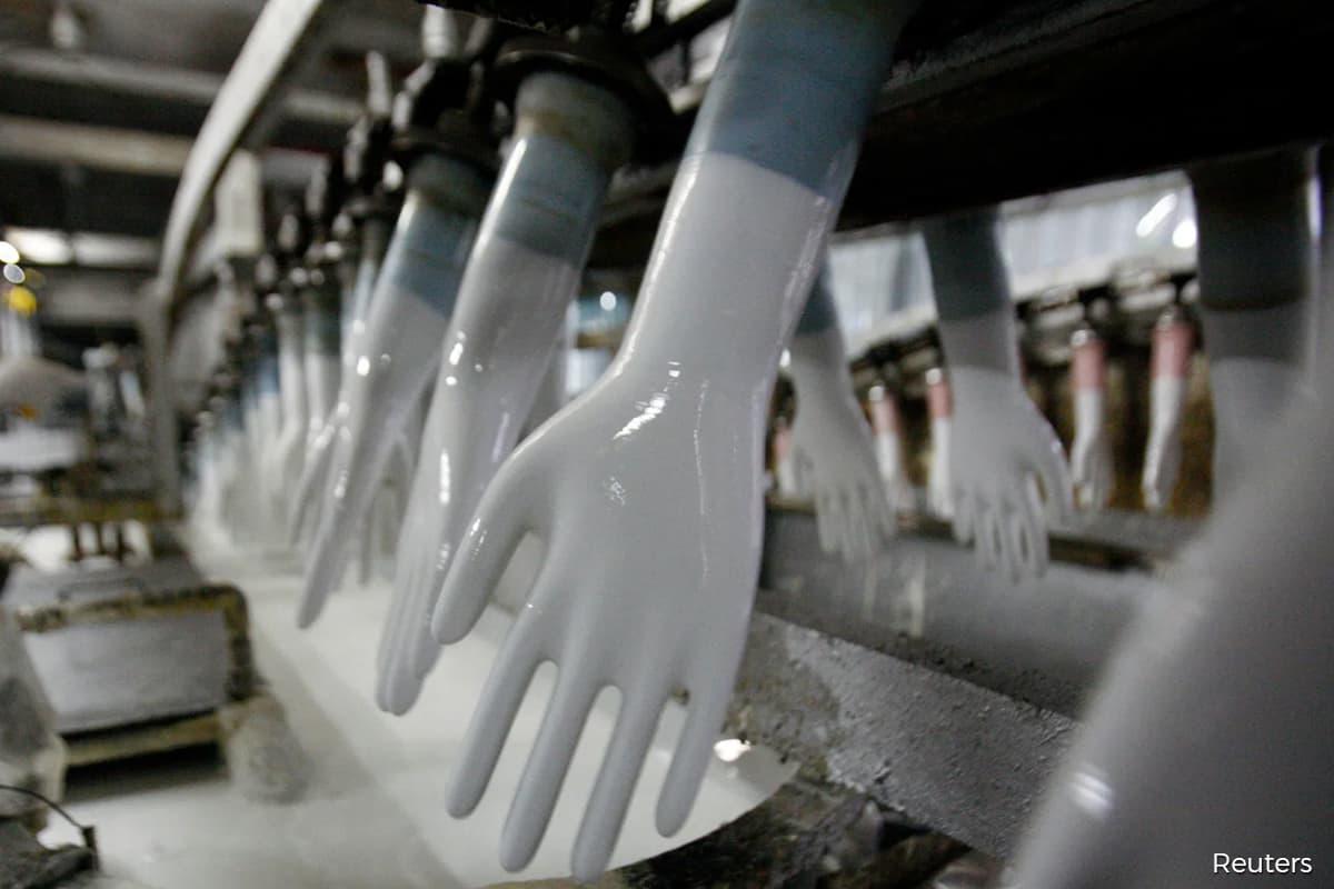 Top Glove, Hartalega fall as Covid-19 drop, vaccine spur sector downgrade
