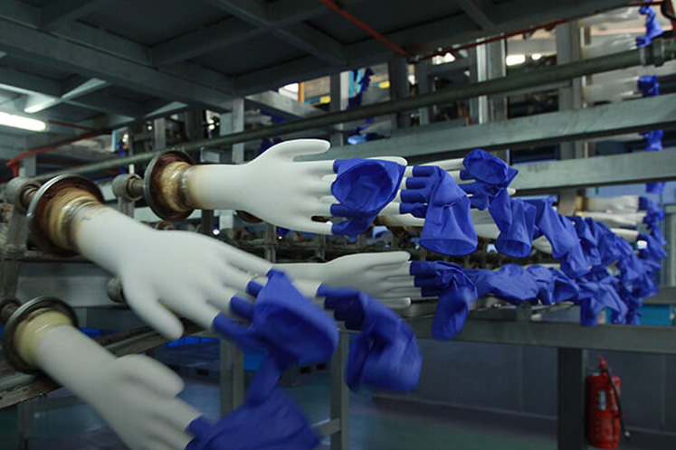 Malaysian firms led by world's top glove maker prioritise medical supplies