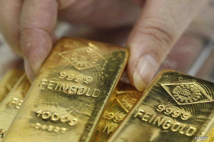Gold futures top $1,400 for first time since 2013 as global central banks turn dovish