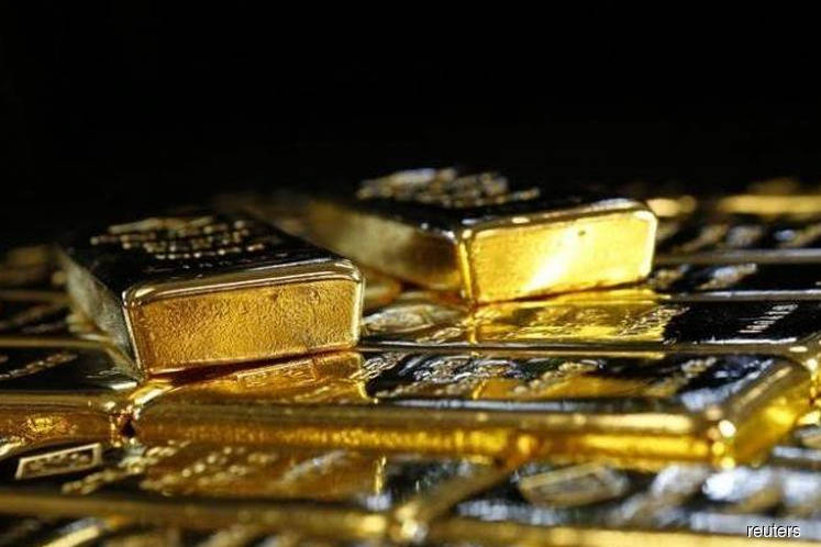 Gold surges to near 14-month peak, on course for fourth weekly gain