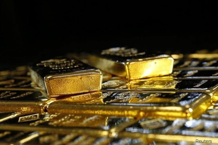 Gold dips on profit taking, firm US dollar ahead of US data