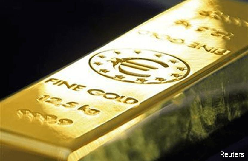 Gold edges down as China demand wanes ahead of Lunar New Year