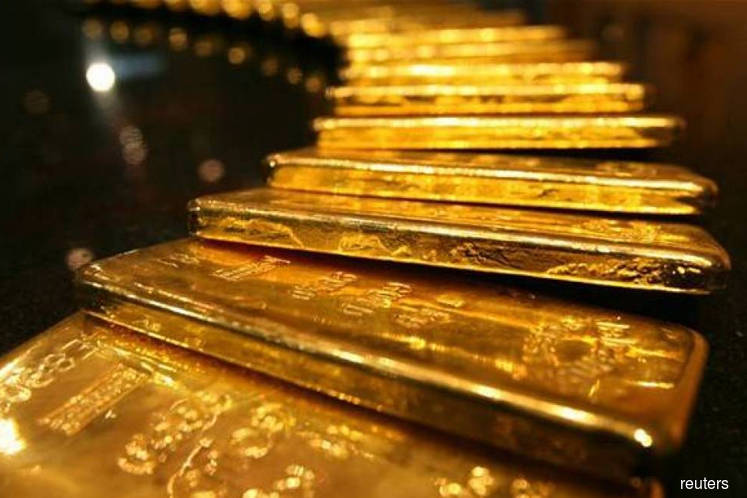 Gold slips from near 8-year peak as stocks firm on upbeat data