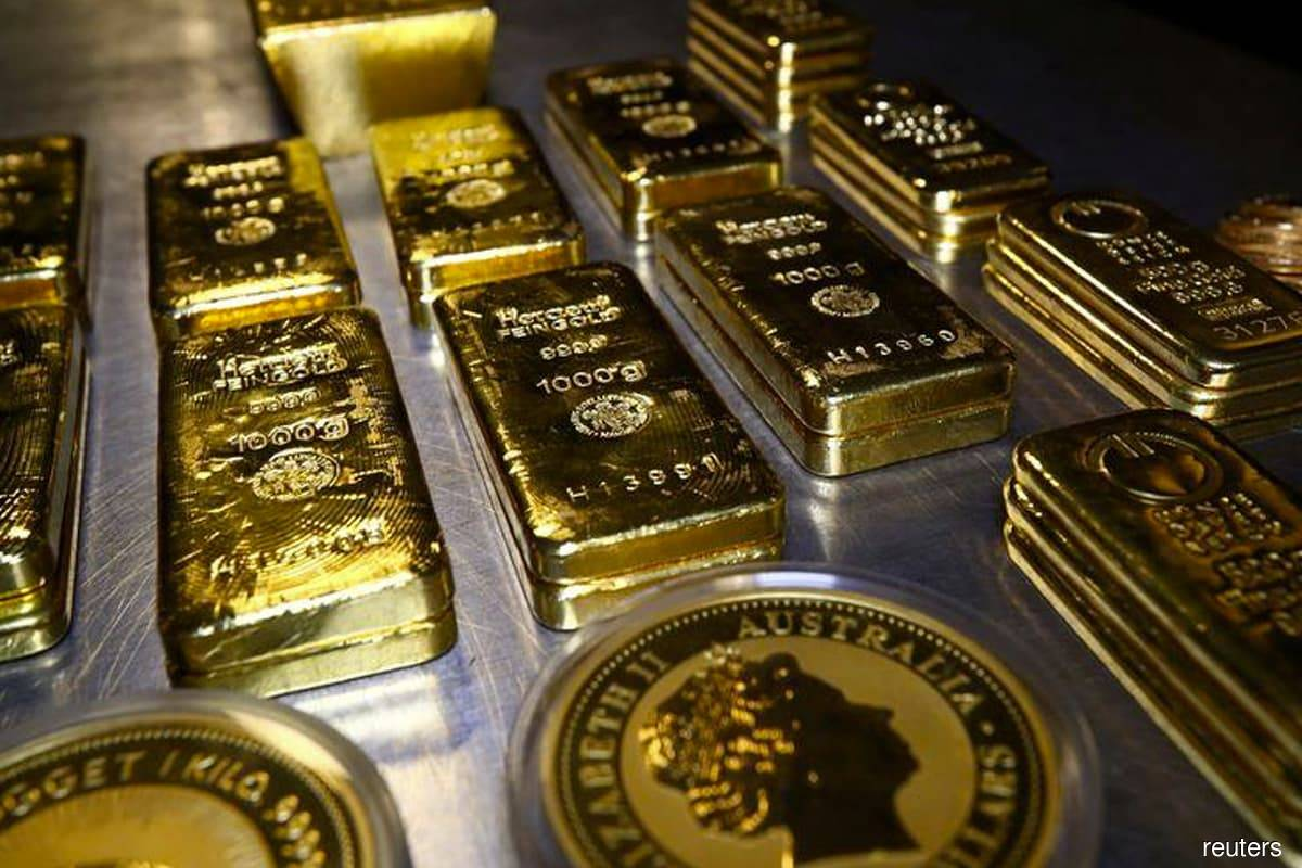 Gold slips after promising China data, set for weekly rise