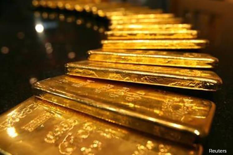 Gold slips on profit taking, firm US dollar
