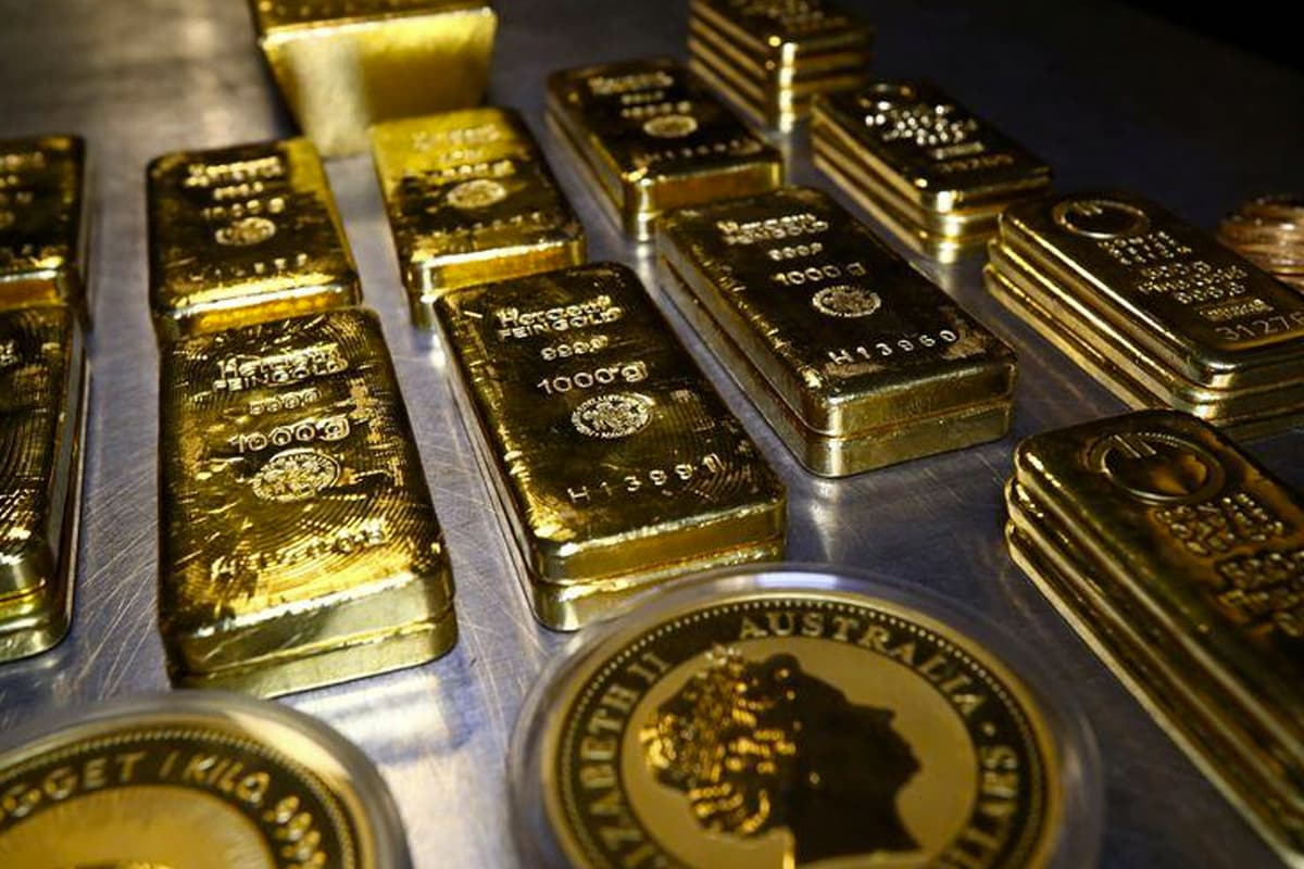 Gold gains on US stimulus deal optimism, weaker US dollar