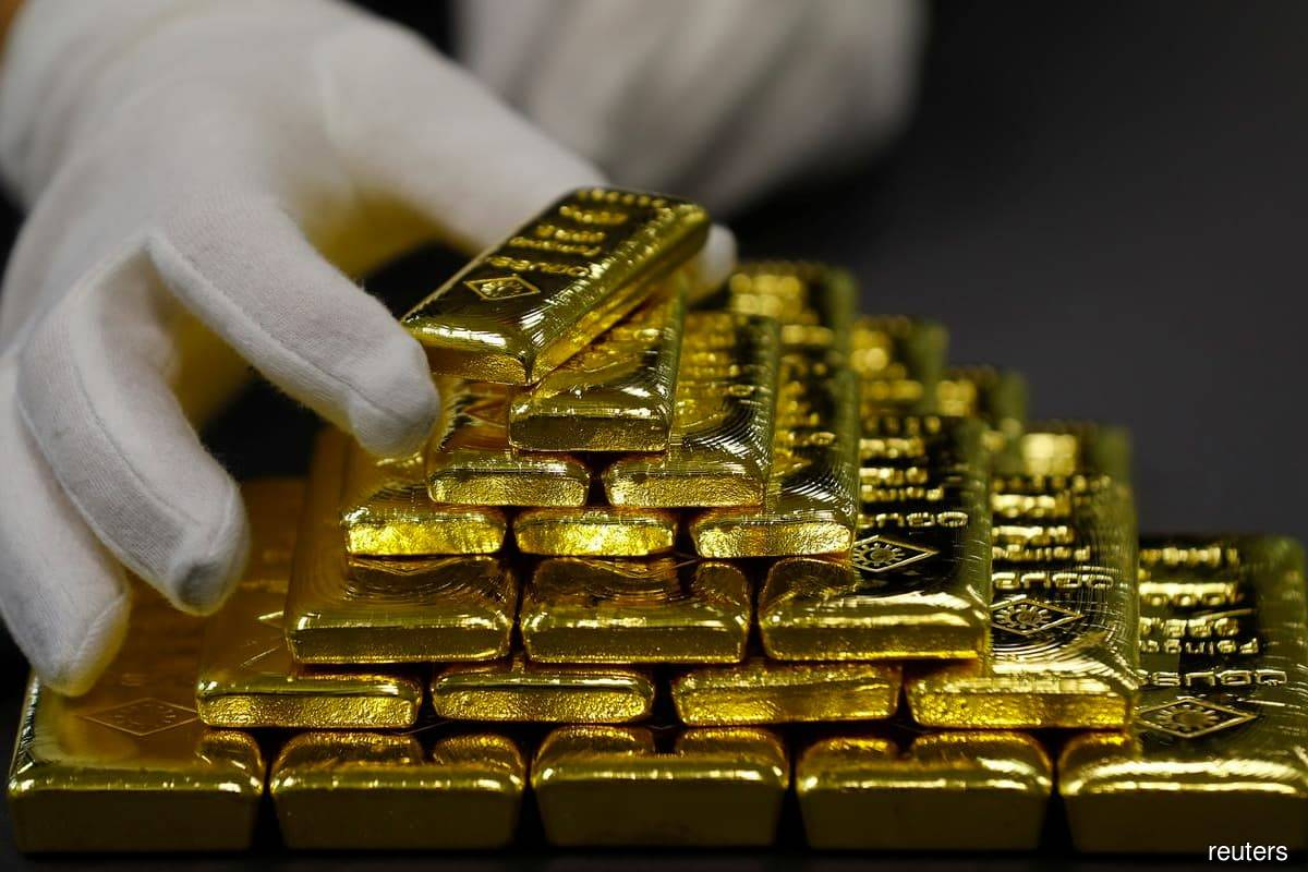 Gold eases as US dollar ticks up
