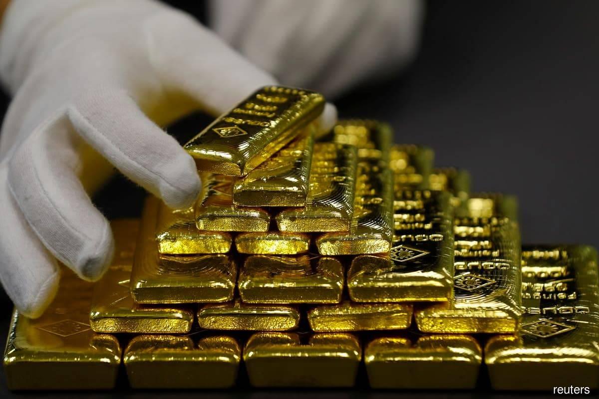 Gold flat as US yields negate firmer dollar