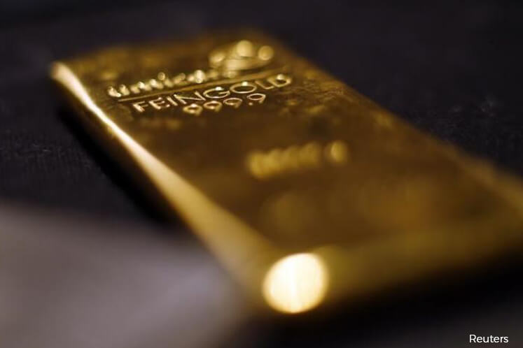 Gold down on US dollar strength, political risks lend support